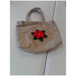 Dolys' handbag and crocheted flower